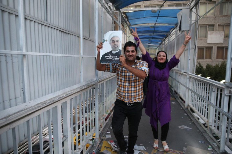 Supporters of moderate cleric Hassan Rohani celebrate his victory in Iran's presidential election on a pedestrian bridge in Tehran June 15, 2013. (Amir Hashen Dehgani/Fars News via Reuters)