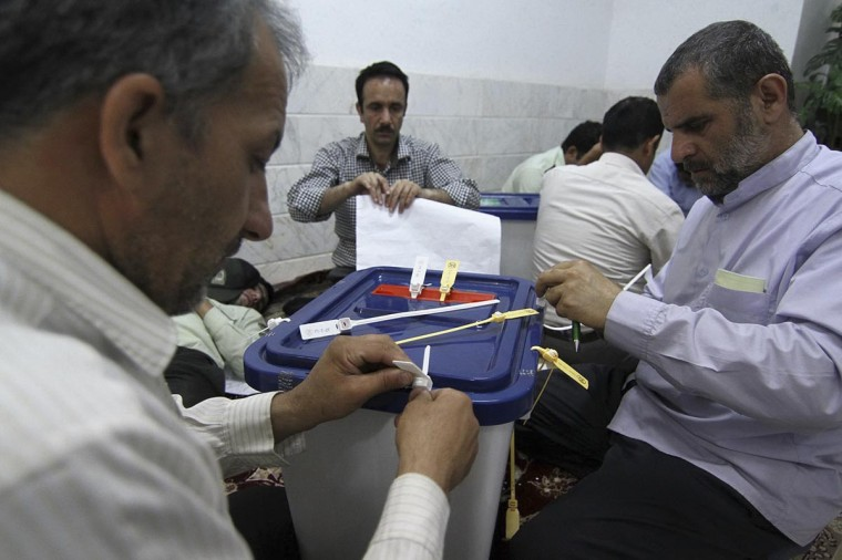 Election officials open sealed ballot boxes as they prepare to count votes for the Iranian presidential elections in Qom, 120 kilometers south of Tehran June 15, 2013. (Seyed Ruhollah Kalantari/Fars News via Reuters)