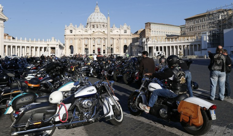 Bikers park their motorcycles in front of St. Peter's square during the Harley-Davidson 110th Anniversary Party in Rome. The celebration will finish with the blessing of 1400 motorcycles at St. Peter's square in the Vatican City on June 16. (Stefano Rellandini/Reuters)
