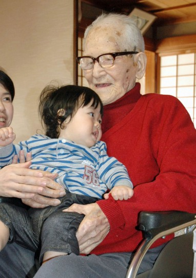 Jiroemon Kimura holds his great-great-grandchild in Kyotango, western Japan, in this photo taken by Kyodo April 19, 2012. The world's oldest person, 116-year-old Japanese man Kimura, died on June 12, 2013, Japanese media said. Kimura, who lived in Kyotango near Kyoto in western Japan, had been hospitalised for pneumonia since last month. He became the world's oldest person on December 17, 2012, after the former title holder, a 115-year-old woman from Iowa died, according to Guinness World Records. (Kyodo/Reuters photo)