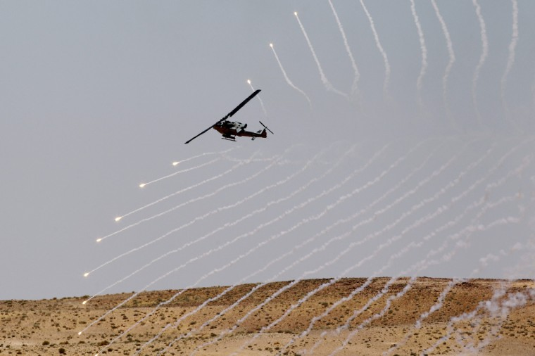 "A helicopter participates in the ""Eager Lion"" military exercises at Al Quwierah near Aqaba city, 290 km (180 miles) south of Amman. Some 8,000 personnel from 19 different nations will be participating in the exercise in Jordan from June 9 to June 20, according to officials. (Muhammad Hamed/Reuters photo)"