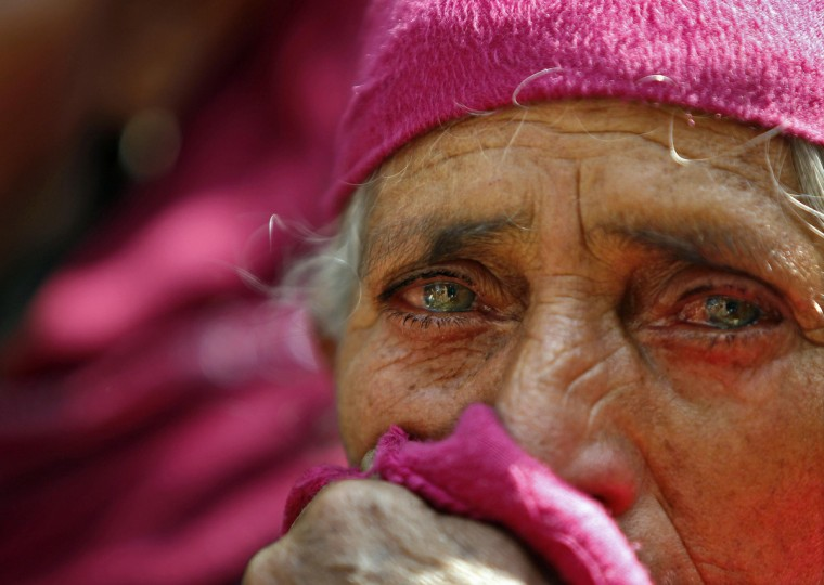 A Kashmiri woman mourns during the funeral of Mohammed Abbas Nangroo, a militant commander at Rajpora, about 50 km (32 miles) south of Srinagar. Two militants including Mohammed Abbas were killed in an encounter between militants and security forces that started on Wednesday in South Kashmir. (Danish Ismail/Reuters photo)