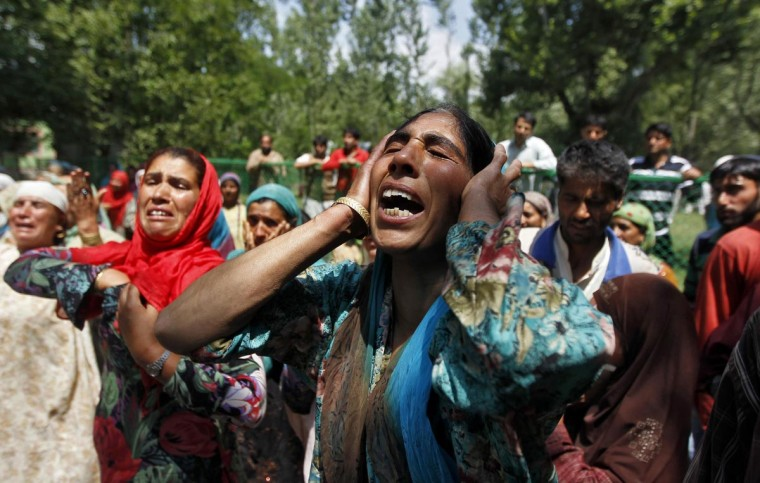 Kashmiri women mourn during the funeral of Irfan Ahmad Ganaie, who was reportedly killed by the Indian army, at Markundal village in the north of Srinagar June 30, 2013. Two people were killed in army firing during an army operation in the village, police said. Major General R. R. Nimbhorkar, the general officer commanding (GOC) of army's Victor Force, said the army has ordered an investigation into the incident. (Danish Ismail/Reuters)