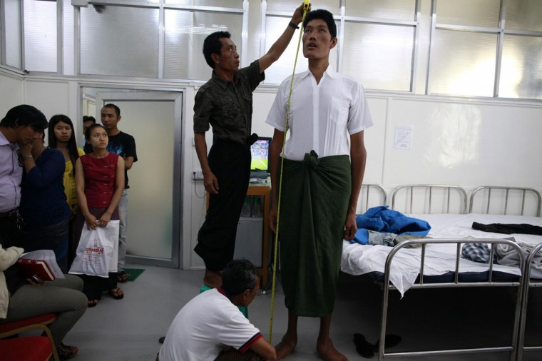 Win Zaw Oo, 36, has his height measured while posing for a photo during a medical check-up at a clinic in Yangon June 30, 2013. Oo, who stands at 7 feet 5 inches tall, is Myanmar's tallest man, according to his medical team. (Soe Zeya Tun/Reuters)
