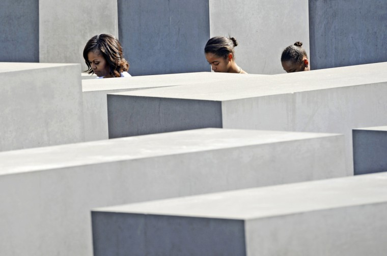 "U.S. first lady Michelle Obama and her daughters Malia (C) and Sasha (R) visit the Holocaust Memorial in Berlin. U.S. President Barack Obama will unveil plans for a sharp reduction in nuclear warheads in a landmark speech at the Brandenburg Gate on Wednesday that comes 50 years after John F. Kennedy declared ""Ich bin ein Berliner"" in a defiant Cold War address. (Jens Meyer/Reuters photo)"