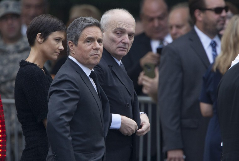 Brad Grey (2nd L), chairman and CEO of Paramount Pictures, and Sopranos creator David Chase (C) arrive at the Cathedral Church of St. John The Divine for the funeral of actor James Gandolfini. (Carlo Allegri/Reuters)