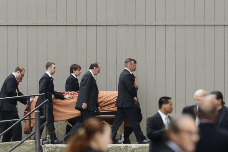 The casket of actor James Gandolfini is escorted into the Cathedral Church of Saint John the Divine for funeral services in New York. (Lucas Jackson/Reuters)