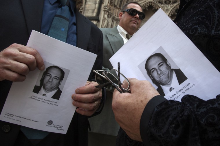 Attendees hold programs outside the The Cathedral Church of Saint John the Divine after taking part in the funeral services for actor James Gandolfini in New York. (Carlo Allegri/Reuters)