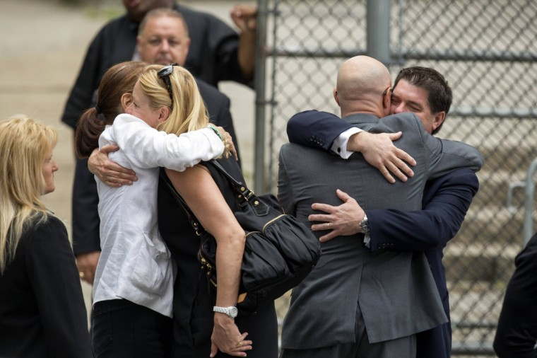 Mourners embrace outside the funeral services of James Gandolfini at the Cathedral Church of Saint John the Divine in New York. (Lucas Jackson/Reuters)