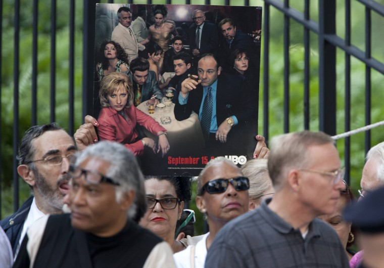 Mourners line up to try and gain admission to the Cathedral Church of St. John The Divine for the funeral of actor James Gandolfini. (Carlo Allegri/Reuters)
