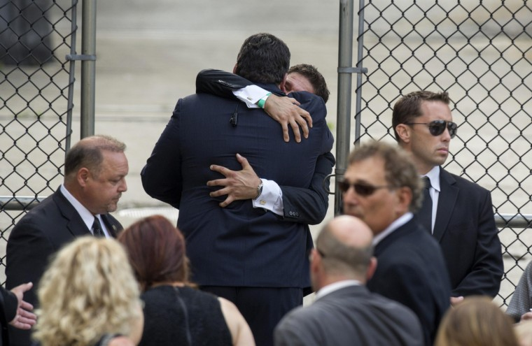 Mourners embrace outside the funeral services of James Gandolfini at the Cathedral Church of Saint John the Divine for funeral services in New York. (Lucas Jackson/Reuters)