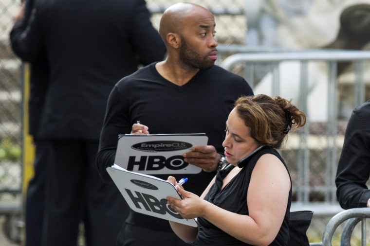 Representatives from HBO hold clipboards outside the funeral services of James Gandolfini outside the Cathedral Church of Saint John the Divine in New York. (Lucas Jackson/Reuters)