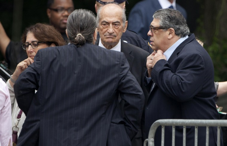 Actor Vincent Pastore (R) arrives at the Cathedral Church of St. John The Divine for the funeral of actor James Gandolfini. (Carlo Allegri/Reuters)