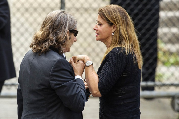 Actor Michael Imperioli holds actress Lorraine Bracco's hand as they arrive for the funeral services of James Gandolfini outside the Cathedral Church of Saint John the Divine in New York June 27, 2013. (Lucas Jackson/Reuters)