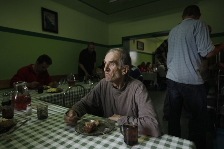 Henryk, 58, who has lived at the Camillian Mission shelter for homeless people for five years, looks out as he eats his meal at the shelter in Warsaw. Food Bank SOS is an organisation that distributes food, including produce that would have otherwise gone to waste, to charities such as the Camillian Mission, which use it to help the needy. Cutting the amount of food that goes to waste is the special theme of this year's World Environment Day on June 5. The U.N. Food and Agriculture Organisation estimates that about a third of all the food produced for human consumption worldwide every year is wasted. Picture taken June 4, 2013. (Kacper Pempel/Reuters)