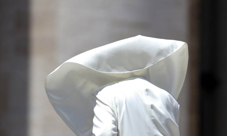 A gust of wind blows Pope Francis' mantle during the weekly audience in Saint Peter's Square at the Vatican. (Tony Gentile/Reuters photo)