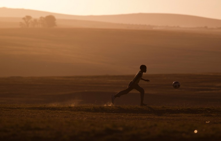 A child plays soccer near former South African President Nelson Mandela's house in Qunu. (Rogan Ward/Reuters)