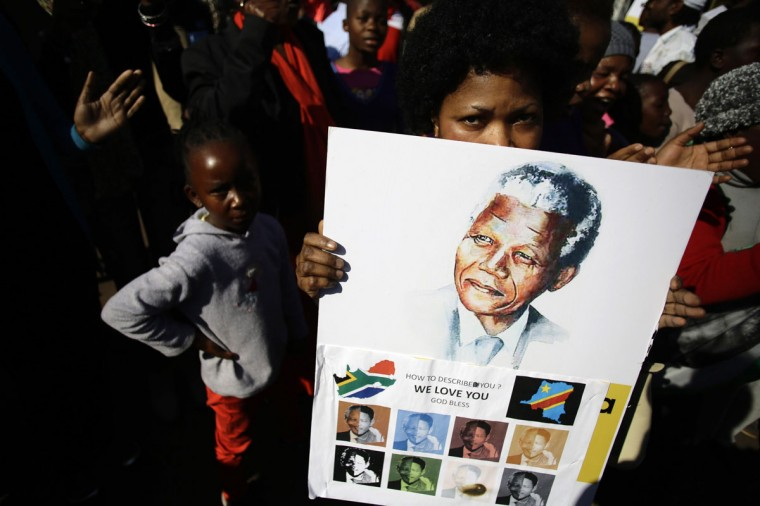 "Well-wishers gather to show support for ailing former South African President Nelson Mandela outside the Medi-Clinic Heart Hospital where he is being treated in Pretoria June 29, 2013. Mandela's condition remains ""critical but stable"" but the government hopes the 94-year-old anti-apartheid hero will be out of hospital soon, President Jacob Zuma said on Saturday. (Kevin Coombs/Reuter)"