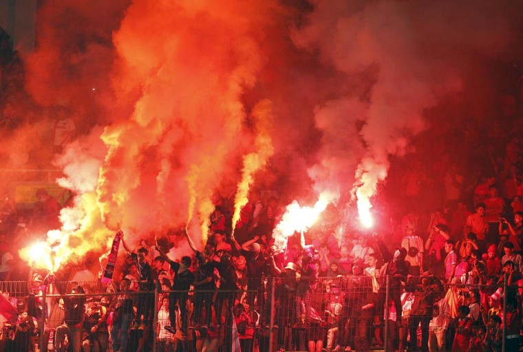 Indonesian supporters light flares during their friendly soccer match against Netherlands in Jakarta June 7, 2013. (Beawiharta/Reuters)