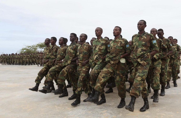 Newly trained Somali military recruits take part in a passing out parade in Mogadishu June 24, 2013. (Feisal Omar/Reuters)