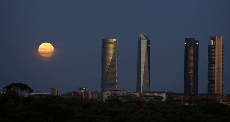 "A ""supermoon"" rises near the Four Towers business district in Madrid, Spain. (Paul Hanna/Reuters photo)"