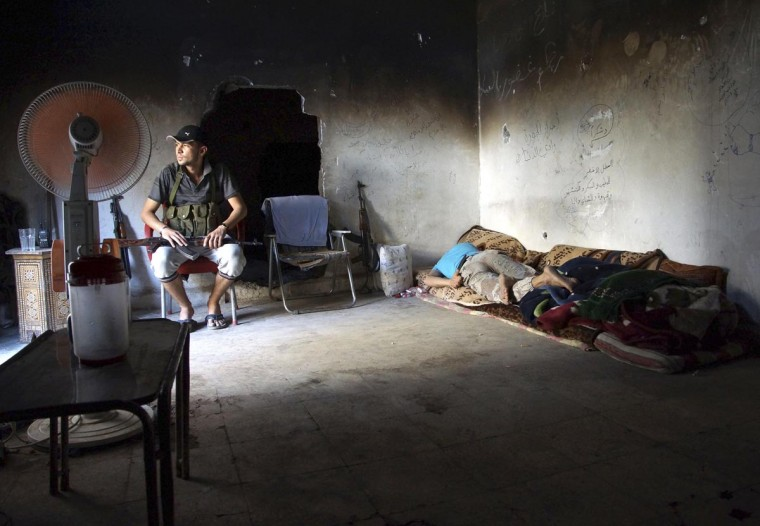 Free Syrian Army fighters rest in a house in Deir al-Zor June 12, 2013. (Khalil Ashawi/Reuters)