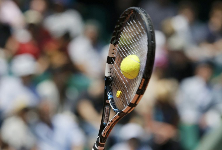 A close up shows the racket of Sara Errani of Italy hitting a tennis ball as she serves to Agnieszka Radwanska of Poland during their women's singles quarter-final match at the French Open tennis tournament at the Roland Garros stadium in Paris. (Gonzalo Fuentes/Reuters)