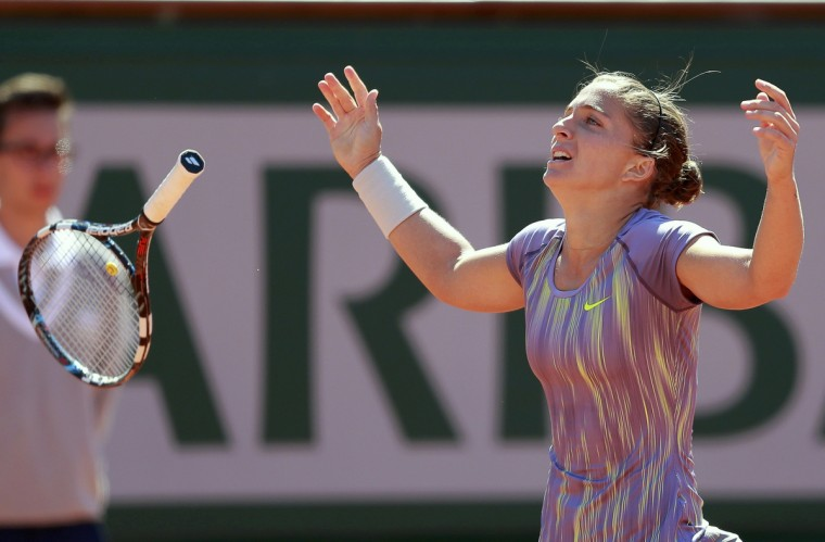 Sara Errani of Italy celebrates defeating Agnieszka Radwanska of Poland in their women's singles quarter-final match during the French Open tennis tournament at the Roland Garros stadium in Paris. Errani proved her run to last year's French Open final was no fluke as she toppled Polish fourth seed Radwanska 6-4 7-6 (6) to reach the semi-finals on Tuesday. (Vincent Kessler/Reuters)