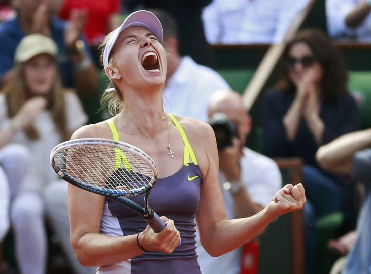 Maria Sharapova of Russia celebrates defeating Victoria Azarenka of Belarus in their women's singles semi-final match during the French Open tennis tournament at the Roland Garros stadium in Paris. Defending champion Sharapova bludgeoned her way past third seed Azarenka 6-1 2-6 6-4 to reach the French Open final on Thursday. (Vincent Kessler/Reuters photo)