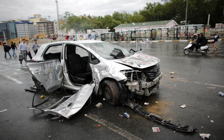 A damaged car is seen in Taksim Square where police and anti-government protesters clashed in central Istanbul June 2, 2013. (Murad Sezer/Reuters)