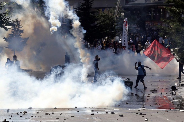 Demonstrators clash with riot police during a protest against Turkey's Prime Minister Tayyip Erdogan and his ruling Justice and Development Party (AKP) in central Ankara June 1, 2013. (Umit Bektas/Reuters)
