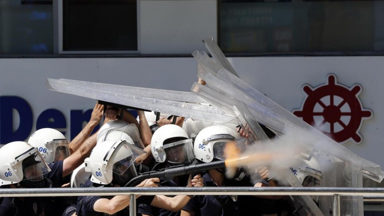 Riot police behind shields fire tear gas during clashes with demonstrators protesting against Turkey's Prime Minister Tayyip Erdogan and his ruling Justice and Development Party (AKP) in central Ankara June 1, 2013. (Umit Bektas/Reuters)