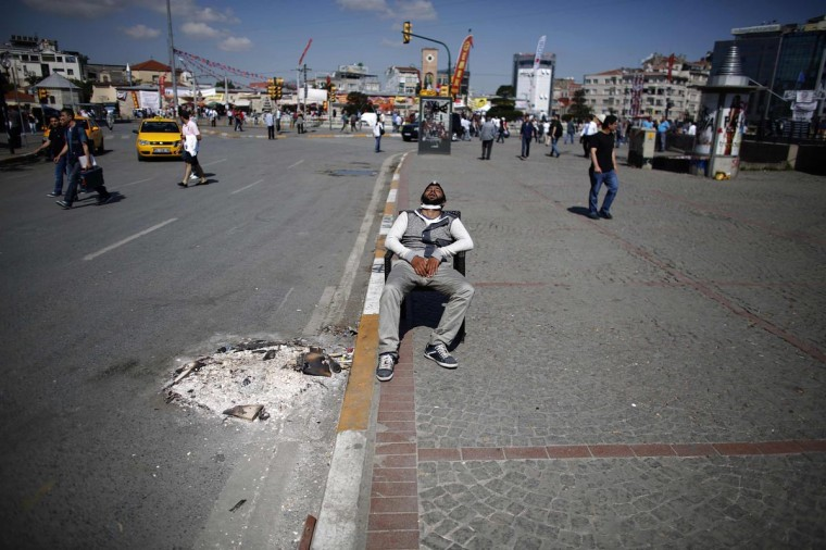 A protester sleeps on a chair at Taksim Square in central Istanbul June 3, 2013. Turkish protesters clashed with riot police into the early hours of Monday with some setting fire to offices of the ruling AK Party as the fiercest anti-government demonstrations in years entered their fourth day.(Stoyan Nenov/Reuters)
