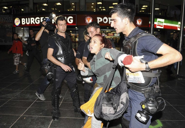 Riot police detain a protester during demonstrations against Turkey's Prime Minister Tayyip Erdogan and his ruling AK Party in central Ankara June 2, 2013. (Stringer/Reuters)