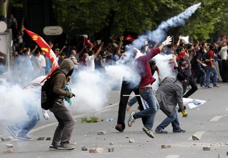 Demonstrators clash with Turkish riot police during a protest against Turkey's Prime Minister Tayyip Erdogan and his ruling AK Party in central Ankara June 2, 2013. (Umit Bektas/Reuters)