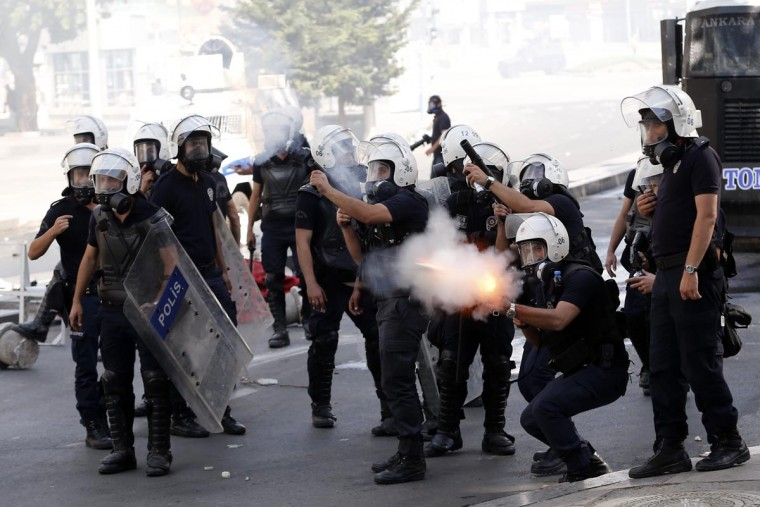 """Riot police fire tear gas against protesters during a demonstration in Ankara June 3, 2013. Turkish Prime Minister Tayyip Erdogan accused anti-government protesters on Monday of walking """"arm-in-arm with terrorism"""", remarks that could further inflame public anger after three days of some of the most violent riots in decades. (Umit Bektas/Reuters)"""