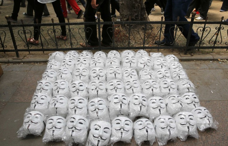 Guy Fawkes masks are seen on the ground as anti-government protesters gather in Istanbul's Taksim square June 4, 2013. Pockets of protesters clashed with Turkish riot police overnight and a union federation began a two-day strike on Tuesday as anti-government demonstrations in which two people have died stretched into a fifth day. (Yannis Behrakis/Reuters)