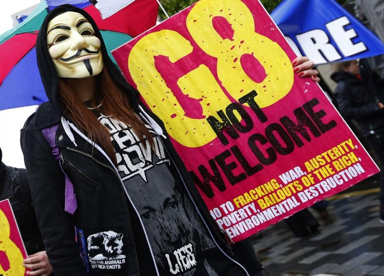 A woman wearing a Guy Fawkes mask takes part in a demonstration in Belfast, against the upcoming G8 summit to be held near Enniskillen, June 15, 2013. Leaders of the G8 countries will meet at Lough Erne in Northern Ireland for the G8 Summit on June 17 and 18. (Yves Herman/Reuters)