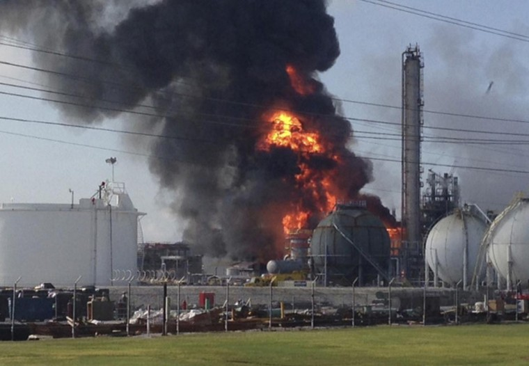 A large fire burns at the Williams Olefins chemical plant in Geismar, Louisiana in this picture taken June 13, 2013. An explosion and fire tore through the chemical plant injuring 33 people and leading authorities to order people within two miles to remain indoors. The blast created a huge fireball and column of smoke. (Picture courtesy of Ryan Meador/Handout via Reuters)