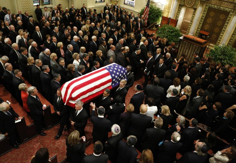 The casket of U.S. Senator Frank Lautenberg is carried from the funeral service at the Park Avenue Synagogue, in New York. Scores of dignitaries filled a New York City synagogue on Wednesday for the funeral of Lautenberg, a Democrat from New Jersey, who was elected to five six-year terms in the Senate. He was the Senate's last surviving World War Two veteran. (Brendan McDermid/Reuters)