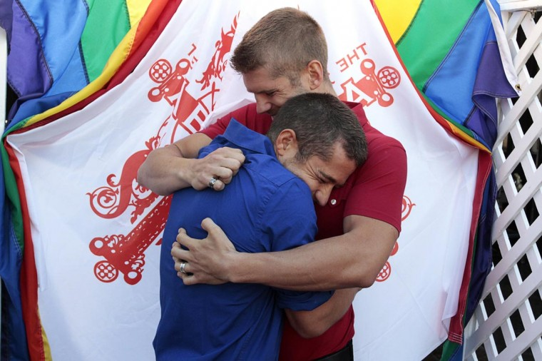 Colby Melvin (L) and Brandon Brown embrace after the U.S. Supreme court ruled on California's Proposition 8 and the federal Defense of Marriage Act, at The Abbey in West Hollywood, California June 26, 2013. (Jonathan Alcorn/Reuters)