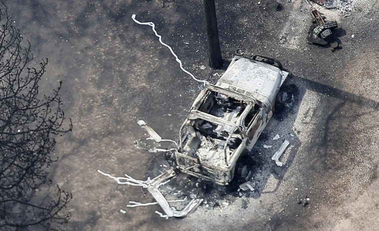 An aerial view of a burnt Jeep with its wheels turned to liquid in the aftermath of the Black Forest Fire in Black Forest, Colorado June 13, 2013. Hundreds of firefighters made a determined stand on Thursday to stop the wildfire that has already destroyed some 360 homes from roaring into the outskirts of Colorado Springs after it billowed overnight into the most destructive blaze in state history. (Rick Wilking/Reuters)