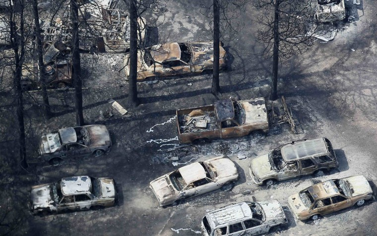 An aerial view of burned out vehicles in the aftermath of the Black Forest Fire in Black Forest, Colorado June 13, 2013. Hundreds of firefighters made a determined stand on Thursday to stop the wildfire that has already destroyed some 360 homes from roaring into the outskirts of Colorado Springs after it billowed overnight into the most destructive blaze in state history. (Rick Wilking/Reuters)