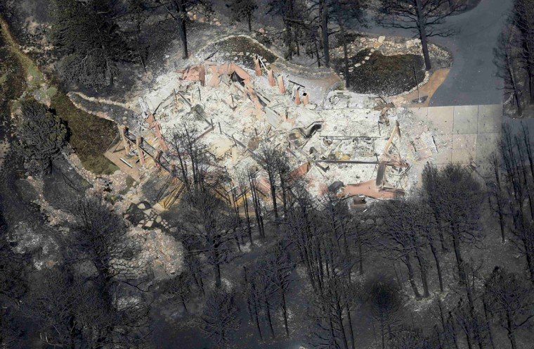 An aerial view of a destroyed house in the aftermath of the Black Forest Fire in Black Forest, Colorado June 13, 2013. Hundreds of firefighters made a determined stand on Thursday to stop the wildfire that has already destroyed some 360 homes from roaring into the outskirts of Colorado Springs after it billowed overnight into the most destructive blaze in state history. (Rick Wilking/Reuters)