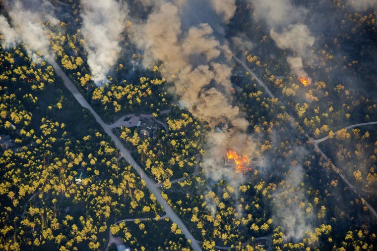 An aerial photo shows a wildfire burning homes in the Black Forest community near Colorado Springs, Colorado June 11 2013. (John Wark/Reuters)