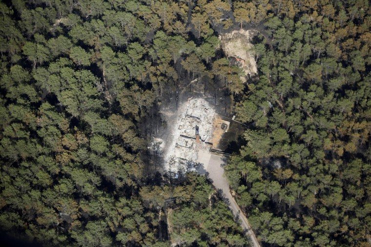 An aerial view of a destroyed house surrounded by dense forest in the aftermath of the Black Forest Fire in Black Forest, Colorado June 13, 2013. (Rick Wilking/Reuters)