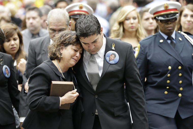 Barbara Perez and David Renaud mourn for Perez' son Captain Matthew Renaud during a memorial service for four Houston firefighters in Houston, Texas. Four firefighters died and 13 others were injured when the roof collapsed while battling a five-alarm fire at a hotel and restaurant in southwest Houston in June. (David J. Phillip/Reuters)