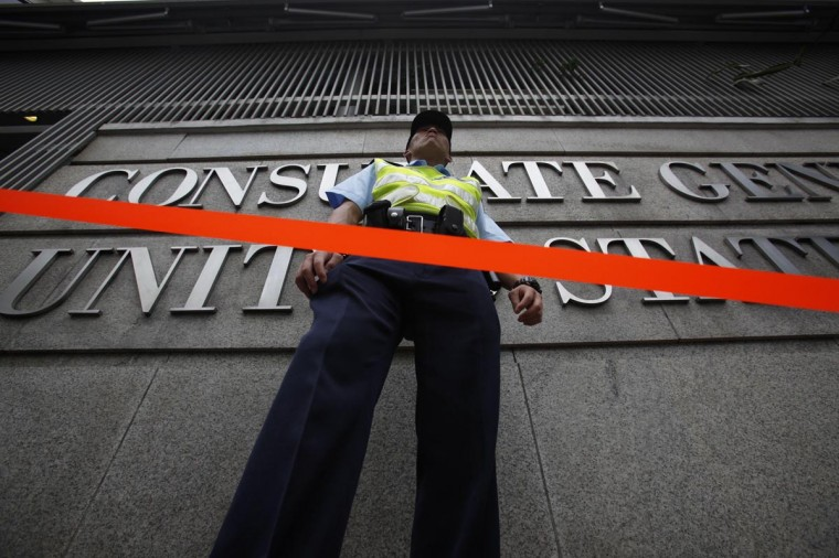 A policeman stands behind a cordon line outside the U.S. Consulate in Hong Kong June 13, 2013. China's Foreign Ministry offered no details on Thursday on Edward Snowden, the National Security Agency contractor who revealed the U.S. government's top-secret monitoring of phone and Internet data and who is in hiding in Hong Kong. (Bobby Yip/Reuters)