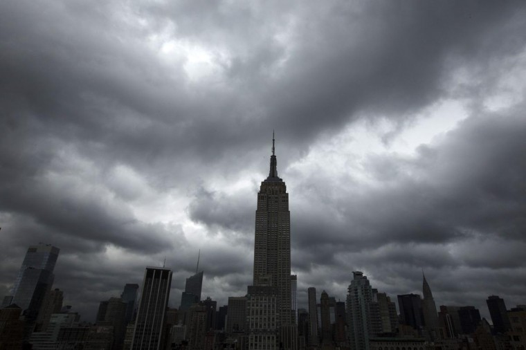Storm clouds pass over the top of the Empire State Building in New York, June 13, 2013. A severe storm system sweeping the U.S. East Coast on Thursday delayed flights and threatened to snarl work commutes a day after causing several tornadoes, damaging hail and high winds across the upper Midwest. (Lucas Jackson/Reuters)