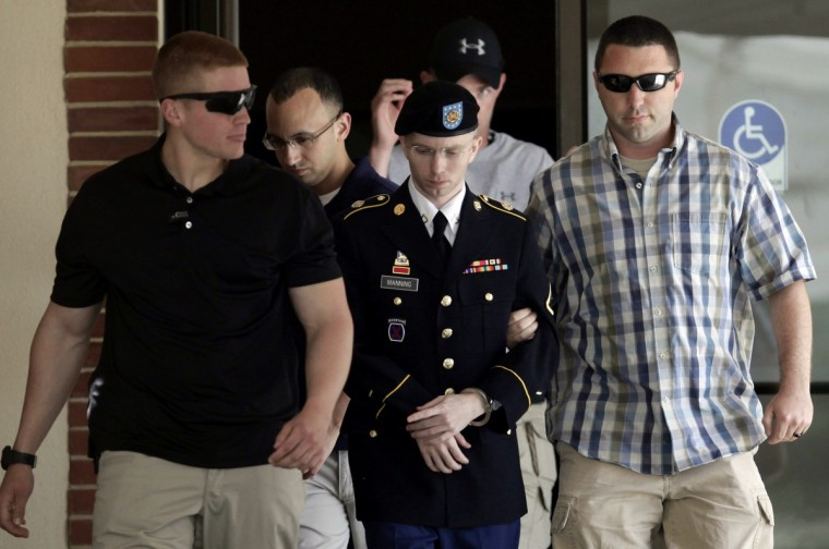 U.S. Army Private First Class Bradley Manning (C) is escorted from the courtroom after a day of his court martial trial at Fort Meade, Maryland. (Yuri Gripas/Reuters)